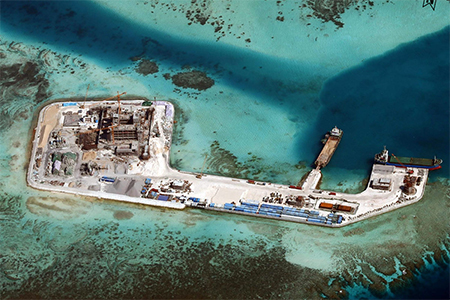 China has begun building a runway on reclaimed land on the Fiery Cross Reef, according to IHS Jane's.