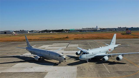A U.S. Navy P-8A Poseidon (left) assigned to the Mad Foxes of Patrol Squadron (VP-5) is seen parked next to the Japanese Maritime Self Defense Force's (JMSDF) maritime patrol aircraft Kawasaki P-1, at Atsugi airbase in Atsugi, south of Tokyo