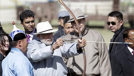 Narendra Modi prepares to loose an arrow during his visit to Mongolia, which has become one of India's strategic partners