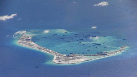 What seem to be Chinese dredging vehicles, in the Spratly Islands in the South China Sea, in an image from a surveillance video.