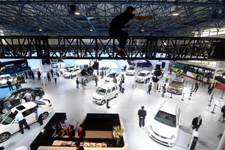 Vehicles are displayed at the 18th China Beijing International High-Tech Expo in the Chinese capital in May. Analysts say the government needs to create a level playing field to allow all types of businesses to flourish. Photo: AFP
