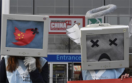 Demonstrators protest for freedom of opinion in China during the opening day of the CeBIT technology fair in Hanover, central Germany, in March 2015.