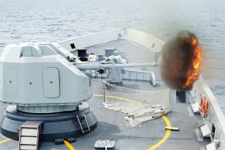Gunnery fired from China's Navy missile frigate Yulin during 'Exercise Maritime Cooperation 2015' by Singapore & Chinese navies in South China Sea.