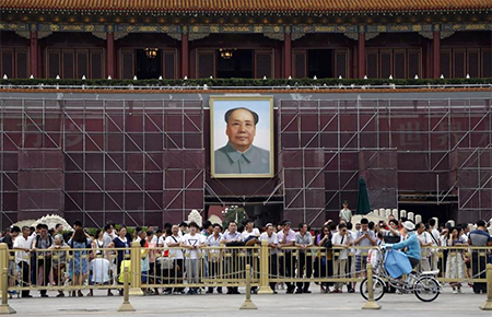 A portrait of Mao Zedong hangs at the Tiananmen Square entrance to Beijing's Forbidden City.