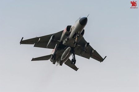A JH-7 carrying two electronic interference pods