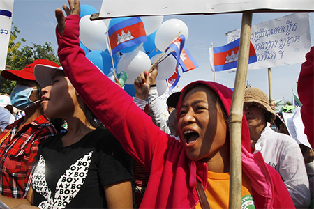 Cambodian garment workers staged a rally to demand higher wages and better working conditions during a gathering to mark May Day celebrations in Phnom Penh, Cambodia in May 2015. (Heng Sinith/AP)