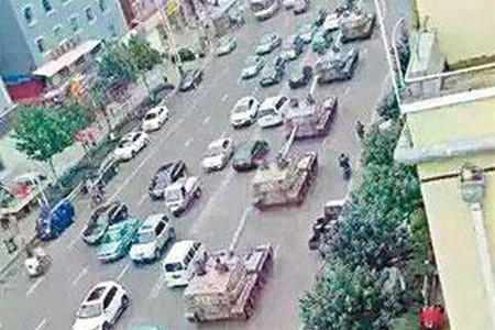 PLA tanks pass through Yanji near the China-North Korea border.