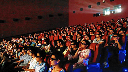 "Hollywood executives have learned to greet news of a partnership with Chinese firms with a degree of skepticism. Above, audiences in China watch a 3-D showing of ""Transformers: Age of Extinction."" (ChinaFotoPress / Getty Images)"