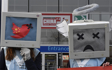 Demonstrators protest for freedom of opinion in China during the opening day of the CeBIT technology fair in Hanover, central Germany, on March 16, 2015