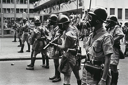 Police prepare to fire tear gas to disperse left-wing demonstrators during the 1967 riots.