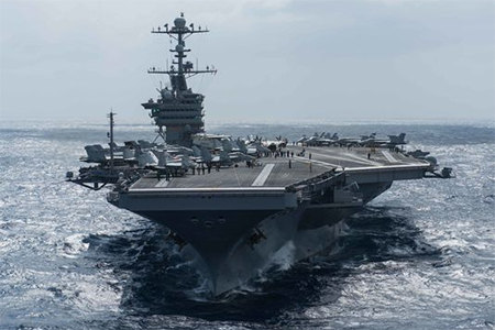 Aircraft carrier John C. Stennis has sailed into the South China Sea to exercise their freedom to navigate through the tense region. The show of force comes a week after the head of U.S. Pacific Command said China was militarising the region.