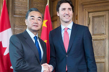 Prime Minister Justin Trudeau meets with Chinese Foreign Minister Wang Yi in Ottawa on June 1, 2016.