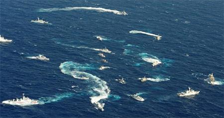 An aerial view shows Japan Coast Guard patrol ship, fishing boats from Taiwan and Taiwan's Coast Guard vessel sailing side by side near the disputed islands in the East China Sea, known as Senkaku in Japan, Diaoyu in China and Tiaoyutai in Taiwan.