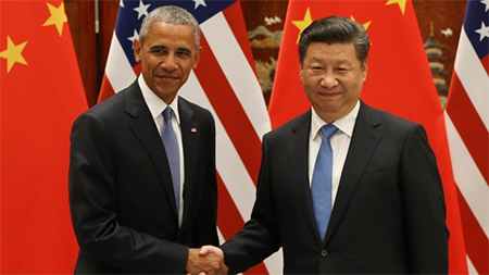 US President Barack Obama, left, and Chinese President Xi Jinping are shown in Hangzhou on Sept. 3. Prior to formally joining the Paris climate deal, the countries two years ago agreed to improve their respective efforts in reducing greenhouse gas emissions. (How Hwee Young/AFP/Getty Images)