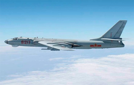 A Chinese military plane H-6 bomber flies through airspace in southern Japan (Reuters)