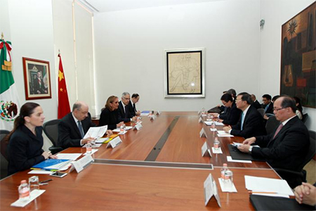 Mexico's Foreign Minister Claudia Ruiz Massieu (3rd L) and Chinese State Councilor Yang Jiechi (2nd R) attend a private meeting at the foreign ministry building (SRE), in Mexico City in this undated handout photo released to Reuters by the Mexican Foreign Ministry office on December 12, 2016. Mexico's Foreign Ministry office/Handout via REUTERS