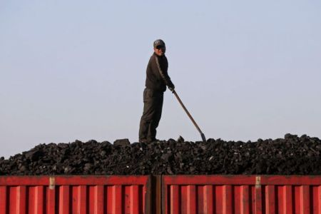 Chinese Worker Loads Coal onto a Truck