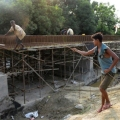 Indian Contruction Workers Building Railway Bridge in Nepal