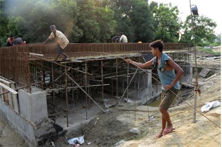 Indian Contruction Workers Building Railway Bridge in Nepal
