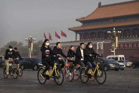 Cyclists Ouside Forbidden City
