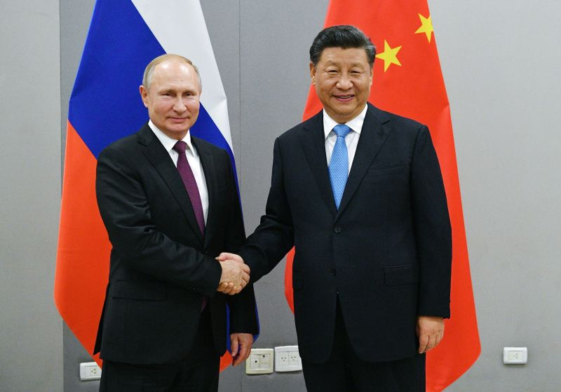 Rulers for life? How Russia's Putin and China's Xi are posing a challenge to the West