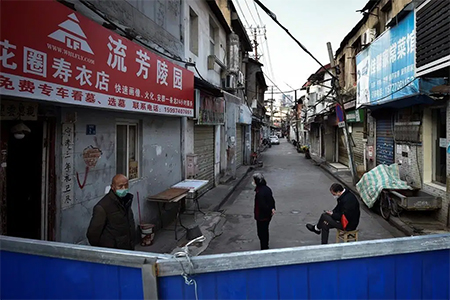 Chinese Volunteer Guarding Barricade to Residential Area