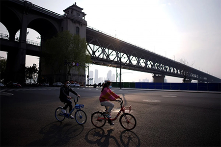 Wuhan waits for coronavirus lockdown to end, but controls on movement likely to remain in force