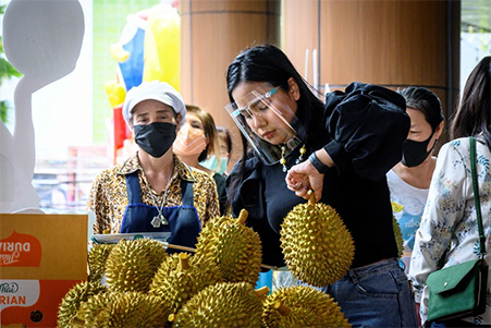 Vendor selling durian in Bangkok