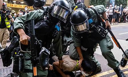 Hong Kong Police Restrain Protester