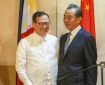 Chinese Foreign Minister Wang Yi (right) and Philippine Foreign Secretary Teodoro Locsin Jnr