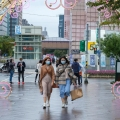 Taiwanese women walk under Christmas decoration in Taipei