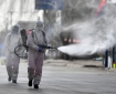 Workers spray disinfectant in Gaocheng district