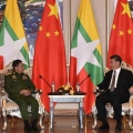 Myanmar's army chief, Senior General Min Aung Hlaing (left), speaking with Chinese President Xi Jinping