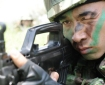 A Chinese soldier eyes a target during a shooting drill