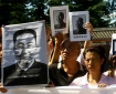 Mourners hold photos of former Chinese premier Hua Guofeng at his Aug. 31, 2008 funeral in Beijing