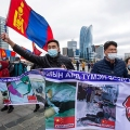 Protesters in Ulaanbaatar, the capital of Mongolia, hold banners and wave the Mongolian flag during a protest against Chinese policies in the neighboring Chinese province of Inner Mongolia