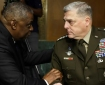 U.S. Defense Secretary Lloyd Austin, left, talks with Joint Chiefs of Staff Chair Gen. Mark Milley