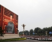 Chinese President Xi Jinping is seen on a giant screen as he delivers a speech at the event marking the 100th founding anniversary of the Communist Party of China, on Tiananmen Square in Beijing, China July 1, 2021