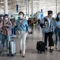 Travelers walk through Beijing Capital International Airport