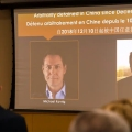 A screen displays images of Canadians Michael Spavor and Michael Kovrig at the Canadian Embassy in Beijing