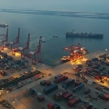 A ship leaves a container port in the evening in Lianyungang in east China's Jiangsu province